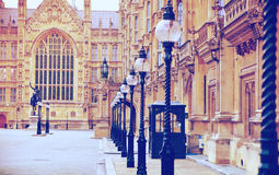 Houses of Parliament and Parliament tower, view from the Abingon St. London Stock Photos