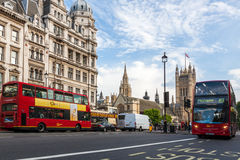 Houses of Parliament and Red Bus in London Stock Photo