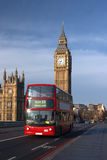 Houses of Parliament with red bus in London. Houses of Parliament with Big Ben tower in London Royalty Free Stock Photos