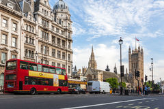 Houses of Parliament and Red Bus in London Royalty Free Stock Images