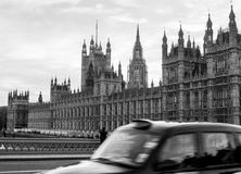 The houses of parliament with taxi passing in front Royalty Free Stock Images