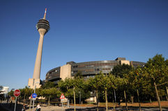 Houses of Parliament under the TV tower. Parliament of North Rhine Westfalia in Düsseldorf, Germany and Rheinturm  in Duesseldorf - TV tower on the river Stock Photos