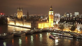 Houses of Parliament Westminster Bridge and Big Ben aerial view by night. LONDON, ENGLAND stock video footage