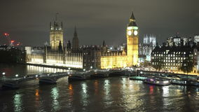 Houses of Parliament Westminster Bridge and Big Ben aerial view by night. LONDON, ENGLAND stock footage