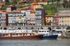 Houses and Passenger Boats in Porto Stock Images