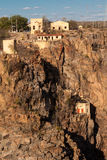 Houses perched on a rocky cliff Stock Photo