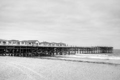 Houses on the Pier. Several houses sit on the pier that goes out into the ocean Royalty Free Stock Images