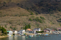 Houses and pier in lake Ashi with nature background Stock Photography