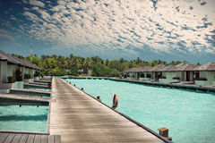 Houses on piles on sea. Maldives.with a retro effect Royalty Free Stock Image