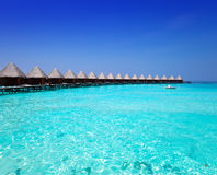 Houses on piles on sea in a sunny day. Maldives Stock Photos