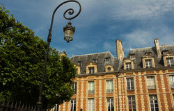 The houses of place des Vosges, Paris, France. The place des Vosges is the oldest planned square in Paris and one of the finest in the city. The housefront are Stock Image