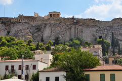 Houses at Plaka neighborhood. And the Acropolis walls, Athens, Greece Royalty Free Stock Photography