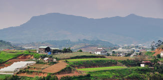 Houses and plantations on the hill at Lang Biang highland in Lam Dong, Vietnam Royalty Free Stock Image