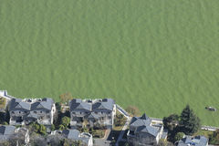 Houses and polluted lake in China Stock Photos