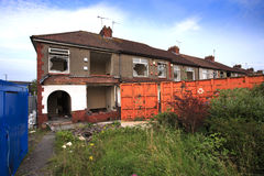 Houses ready to be demolished with skip Stock Photos