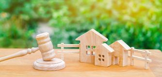 Houses / real estate and a hammer of the judge. court and division of property. concept of law and lawyer, judiciary and legislatu. Re. lawyers, notaries and royalty free stock photo