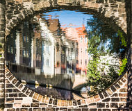 Houses reflected in river under bridge -Nuremberg, Germany Stock Image