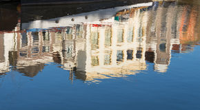 Houses reflected in the water Stock Images