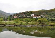 Houses reflected in water - Douro river. Photo of some houses reflected in water at Douro river bank - Trás-os-Montes and Alto Douro Province - Portugal royalty free stock photography