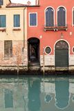 Houses reflecting in the narrow canal in Venice, Italy royalty free stock photo