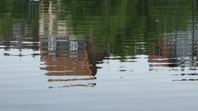 Houses reflection in a lake stock video footage