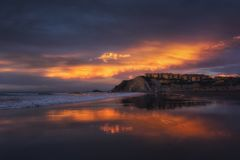 Houses reflection on the Sopelana beach at sunset Royalty Free Stock Images
