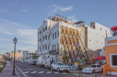 Houses with reinforcements in Old San Juan. San Juan, Puerto Rico, USA - Jan. 2, 2018: Houses with reinforcements after hurricane Maria, with Puerto Rican flag royalty free stock photography