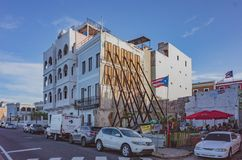 Houses with reinforcements in Old San Juan. San Juan, Puerto Rico, USA - Jan. 2, 2018: Houses with reinforcements after hurricane Maria, with Puerto Rican flag royalty free stock images
