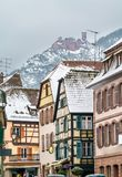 Houses in Ribeauville and the Saint Ulrich Castle in the Vosges Mountains. Alsace, France. Houses in Ribeauville and the Saint Ulrich Castle in the Vosges Stock Photography