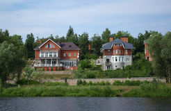 Houses on river bank Royalty Free Stock Photo
