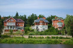 Houses on river bank Stock Image