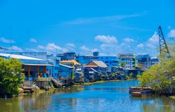 Houses on the river have a variety of colors stock image