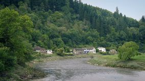 Pretty Rural Scene With Houses By The River stock footage