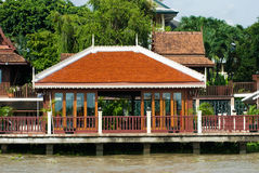 Houses by the river in Thailand royalty free stock photography