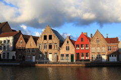 Houses at the riverside, Bruges. Houses at the riverside with late afternoon sunshine reflecting on the bricks, Bruges, Belgium Royalty Free Stock Photography