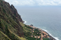 Houses and road on the ocean shore the island of Madeira. Royalty Free Stock Photos