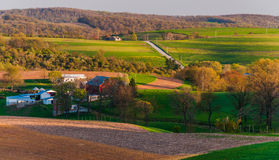 Houses, roads, farm fields and rolling hills of Southern York County, PA Stock Photos