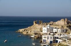 Houses rock cliffs Firopotamos Milos Stock Photo
