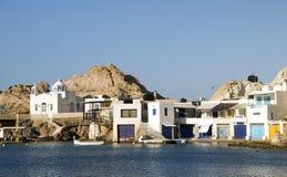 Houses rock cliffs Mediterranean Sea Firop stock images
