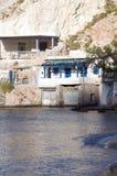 Houses rock cliffs  Mediterranean Sea Firop Royalty Free Stock Photos