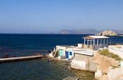 Houses rock cliffs Mediterranean Sea Milos royalty free stock image