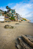 Houses and rocks on the beach  Stock Photography