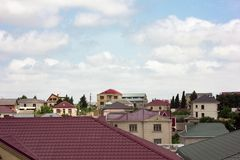 Houses roofs and blue sky royalty free stock photography