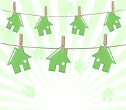 Houses on rope on sunny background. Royalty Free Stock Images