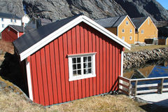 Houses and Rorbuer mirroring Nusfjord stock photo