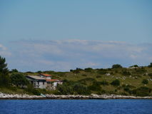 Houses in the rough landscape of the island Kornat Royalty Free Stock Photo