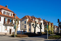 Houses in row. Houses in a row on blue sky as background Stock Photos