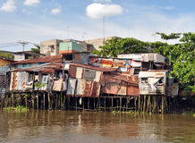 Houses beside the Saigon River, Ho Chi Minh City. Royalty Free Stock Images