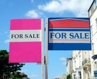 Houses for sale signs. Two houses for sale signs in English street Stock Images