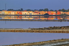 Houses at Salin de Giraud, Camargue, France. Colorful houses reflecting in water at Salin de Giraud, Camargue, France stock image